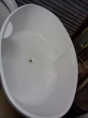 large oval build in tile in bath thin rim